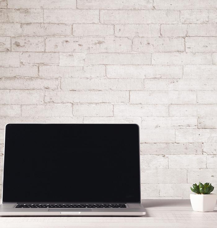 laptop on desk in modern home